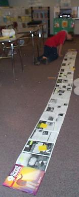 Photograph: An unrolled scroll on the floor of a middle school classroom.
